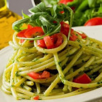 photo of delicious pasta with arugula pesto and cherry tomatoes